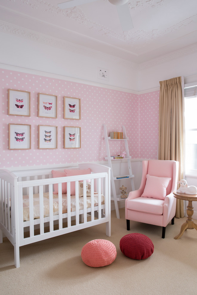 baby girl bedroom themes crib patterned wallpaper chair pouffes sidetable ladder framed painting transitional design