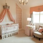 baby girl bedroom themes crib sidetable couch pillow window curtains chandelier traditional design