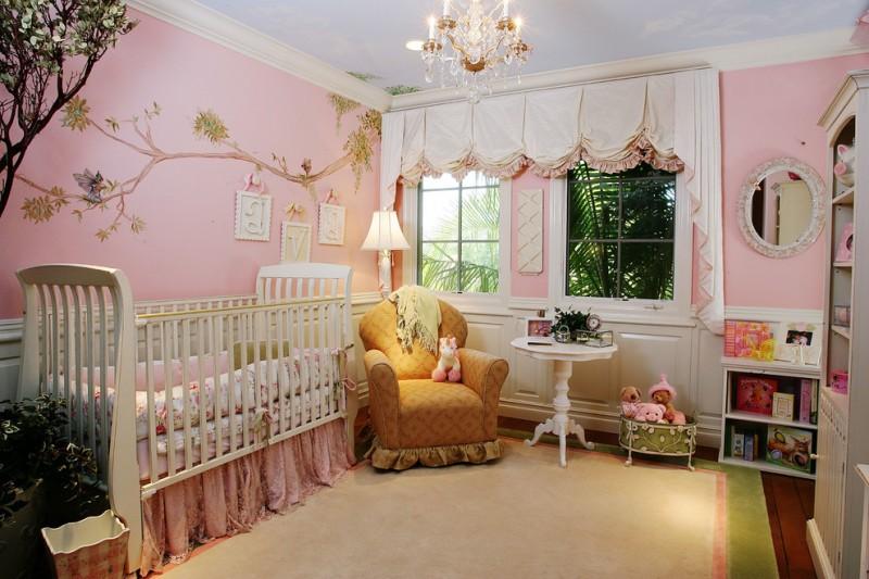 baby girl bedroom themes crib slipcovered chair shelves basket storage mirror chandelier carpet hardwood floors round table chandelier lamp traditional design