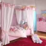 baby girl bedroom themes four post bed sidetable table lamp cabinet curtain carpet stuffed animals toys carpet hardwood floors traditional design
