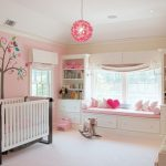 baby girl bedroom themes nook wallpaper crib pendant carpet beige floor cabinet shelves stuffed animals windows transitional design
