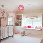 baby girl bedroom themes nook wallpaper crib pendant carpet beige floor cabinet shelves stuffed animals windows transitional design