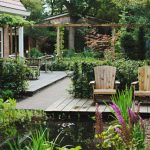 back yard pond chairs plants house exterior traditional landscape