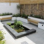 Back Yard Pond Plants Benches Stone Wall Outdoor Area Contemporary Patio