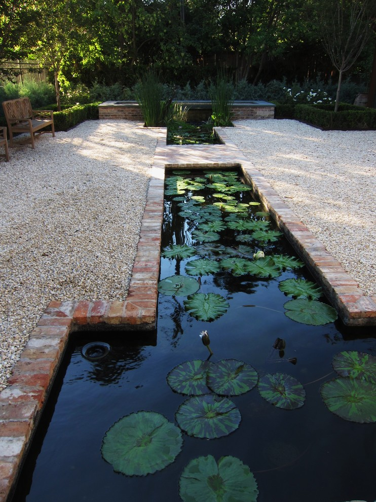 back yard pond plants fence seating water outdoor area traditional landscape