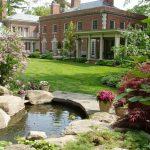 Back Yard Ponds Flowers Stones House Grass Pillars Windows Traditional Landscape