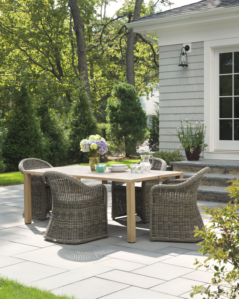 backyard patio designs chairs table flowers plates grass tree traditional outdoor area