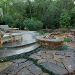 backyard patio designs stones firepit plants table couch flowers tree tropical outdoor area