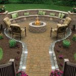 Backyard Paver Ideas Grass Black Iron Cushioned Chairs Small Iron Side Tables Patio Stone Bench Decorative Flowers