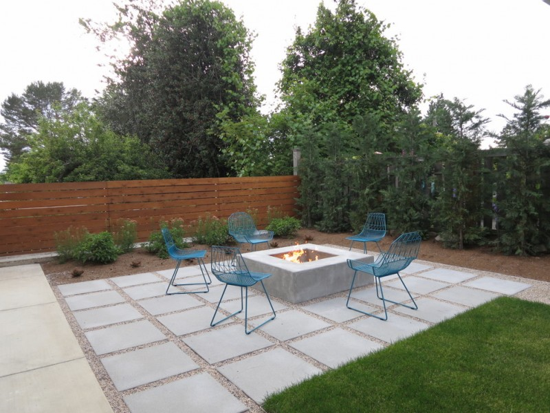 backyard paver ideas grass farmhouse blue chairs baltic propane square fire table crushed stones with paver wooden privacy fence