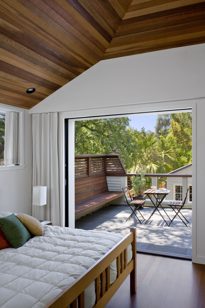 balcony with white wooden deck in the front, brown wooden deck with wooden built in benchm wooden small chair with table