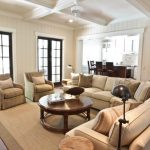 Beach Style Living Room With Sectional Sofa Carpet Pillows Lamps Round Top Table Ceiling Fan Chairs
