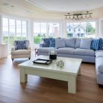 Beach Style Living Room With Sectional Sofa Pillows Wall Tv Table Chair