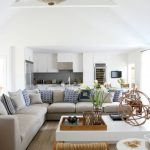 beach style living room with sectional sofa white table curtains flowers pillows bench wall cabinets