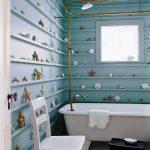 Beach Themed Bathroom Decor Blue Shells Shelving Golden Curtain Rod Shower And Faucet White Bathtub Square Glass Window