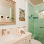 Beach Themed Bathroom Decor Fish Towel Holder Silestone Countertop Blue Sea Shower Tiles Shower Glass Door Toilet Wood Ceiling
