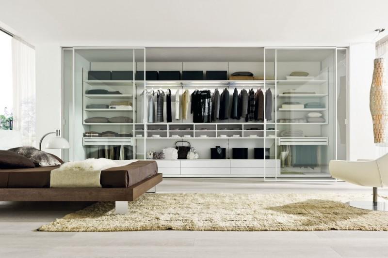 big walk in closet carpet bed pillows lamp window curtain shelves clothes bags modern bedroom
