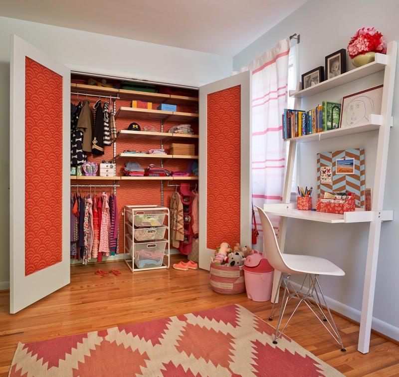 big walk in closet carpet chair window curtain shelves clothes midcentury bedroom