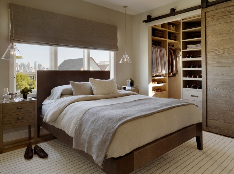 big walk in closet carpet shoes hanging lamp window bed pillows blanket bedside tables clothes contemporary bedroom