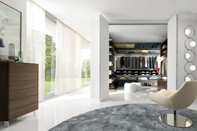 big walk in closet curtains clothes chair carpet shelves glass modern bedroom