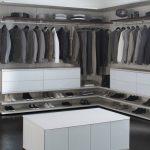 big walk in closet dark floor clothes shoes shelves contemporary bedroom