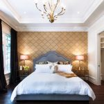 big walk in closet wood bed pillows windows bedside tables lamps curtains wall patterns clothes chandelier contemporary bedroom