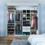 Big Walk In Closet Wood Floor Carpet Bed Shelves Drawers Clothes Shoes Ceiling Lights Contemporary Bedroom Cool Sliding Doors