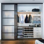 Big Walk In Closet Wood Floor Carpet Clothes Shoes Sliding Door Contemporary Bedroom Shelves Drawers Ceiling Lights