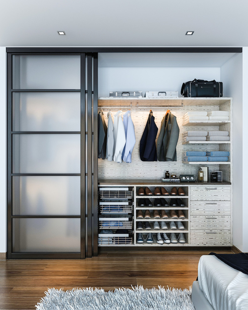 big walk in closet wood floor carpet clothes shoes sliding door contemporary bedroom shelves drawers ceiling lights