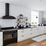 Black Appliances Black Hood Built In Cabinet White Cabinet Tiled Wall Wooden Floor Black Table Floating Shleves Recessed Lights