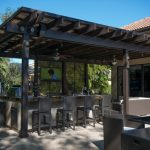 Black Pergola With Canopy Outdoor Kitchen With Mini Bar And Stools Concrete Floors Black Shutter For Pergola