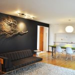 Black Wall Black Chaise Lounge Willow Branches Pendant Light White Stool Lightwood Floor Ceiling Lights Rug Area