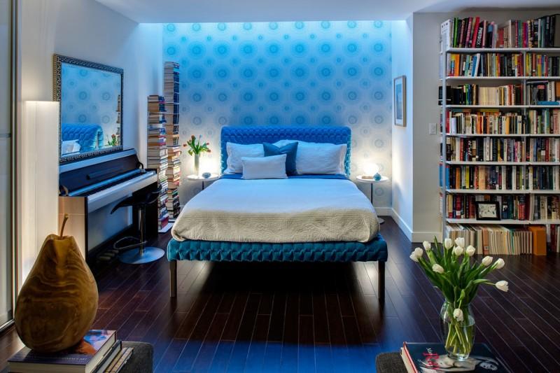 blue bed frame with headboard white bedding idea dark toned woodboard floors blue polka dots wallpaper white walls white book rack