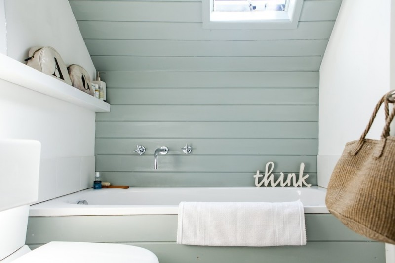 boarded tub front and accent wall bags and basket for bathroom organizer grey painted deck wooden wall and ceiling white walls