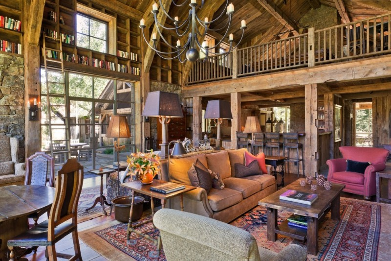 cabin designs and floor plans carpet hardwood floor chandelier table chairs ladder bookshelves rustic family room