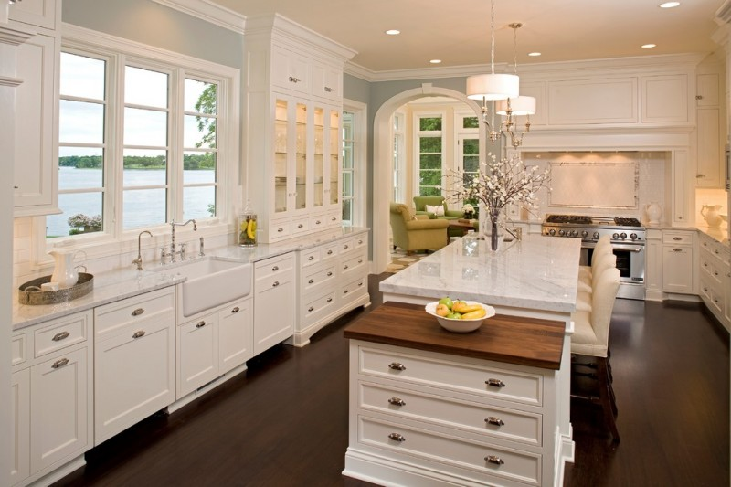 country kitchen paint colours dark floor chairs island flowers chandelier stove glass front wall cabinets window sink faucet traditional kitchen
