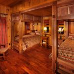 cabin designs and floor plans wood floor beds small tables lamps rocking chair windows curtain rustic bedroom