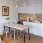 Compact Kitchen Units White Kitchen Cabinet Small Wooden Dining Table With Transparent Chairs Cute Pendat Lights Wood Floor Small Kitchen