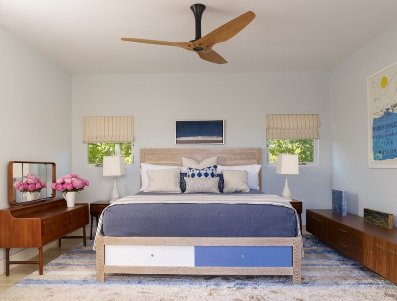 contemporary bedroom with blue bedding treatment natural wooden bed frame plus headboard custom wood vanity with mirror custom wood console table extra sized area rug