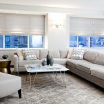 contemporary living room with sectional sofa windows table lamp chair ceiling lights