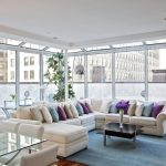 Contemporary Living Room With Sofa Pillows In Varying Colours Carpet Wood Floor Cool Tables Lamps Flowers Decorative Plant Glass Door
