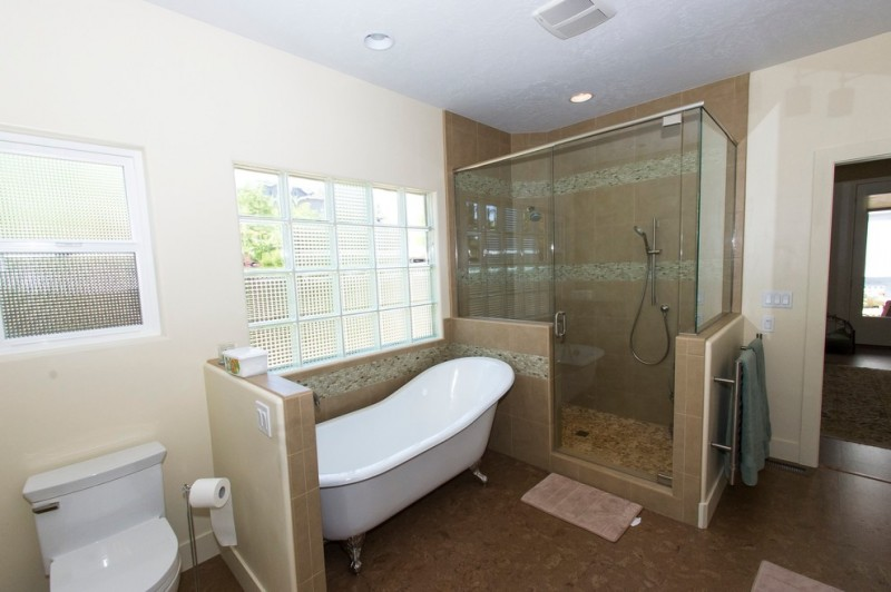cork flooring for bathroom bathtub shower area large towel holder full glass shower door good lighting bathroom window