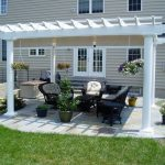 Country House With Patio And White Finishing Pergola Black Furniture For Patio Concrete Floors
