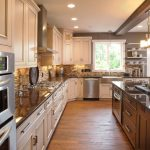 country kitchen paint color wood floor wall shelves backsplash chandelier ceiling ligths cabinets window stove dark countertop traditional kitchen