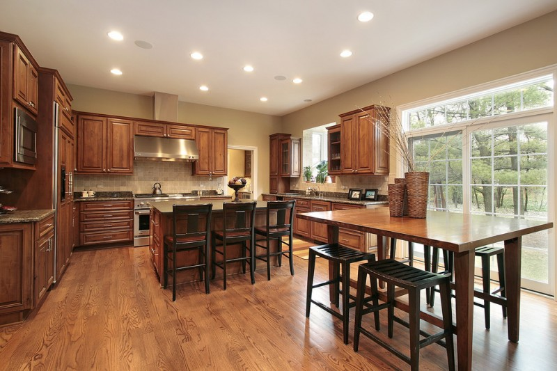 country kitchen paint colour relaxed khaki wall beautiful floor stools table ceiling lights wall cabinets island chairs traditional kitchen