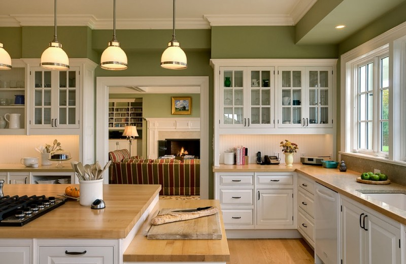 country kitchen paint colours light wood coloured floor island countertop glass front wall cabinets stove cool lamps green walls traditional kitchen