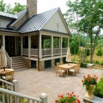 Country Living House Plans Gray Metal Roof Cream Market Umbrella Wooden Patio Furniture House On Covered Piling Paver Home Decorative Plants