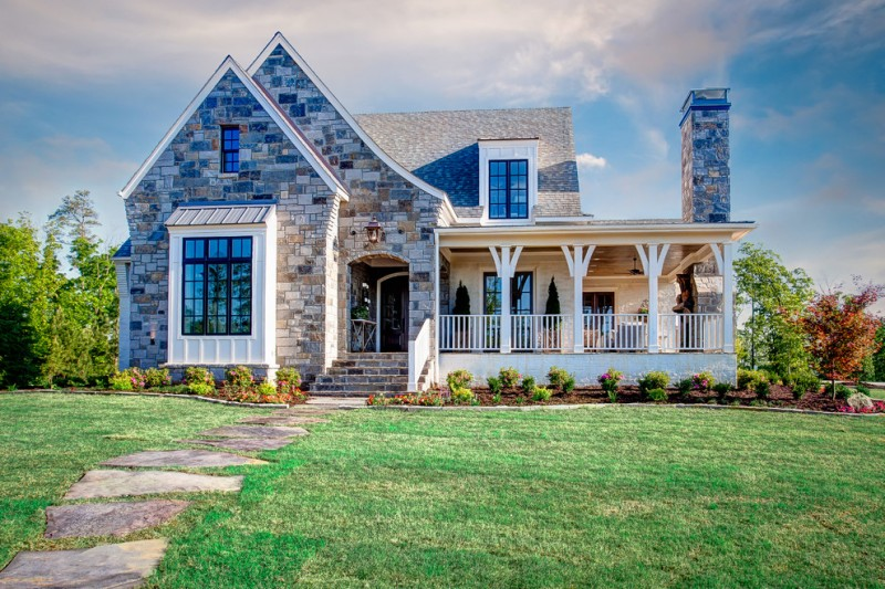 country living house plans pop blue mosaic stones home white wood railing white piles large glass window small narrow glass dormer outdoor entryway table with plants