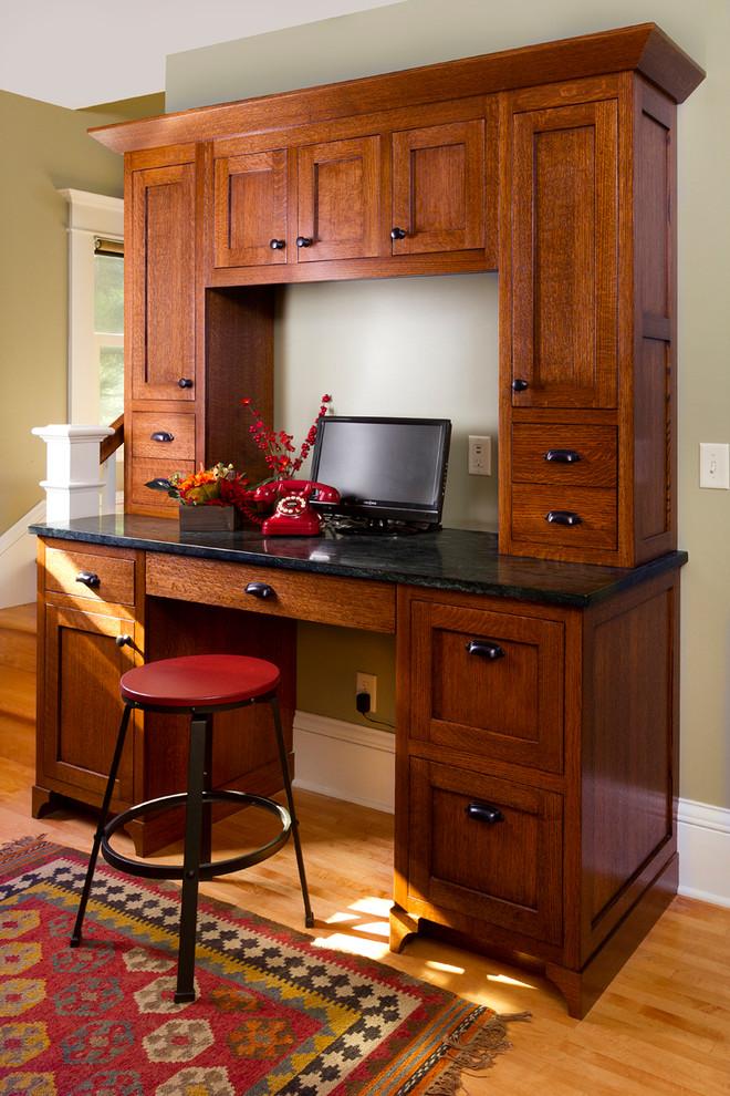 craftsman home office idea with dark hardwood working desk medium toned wood floors tribal colored area rug