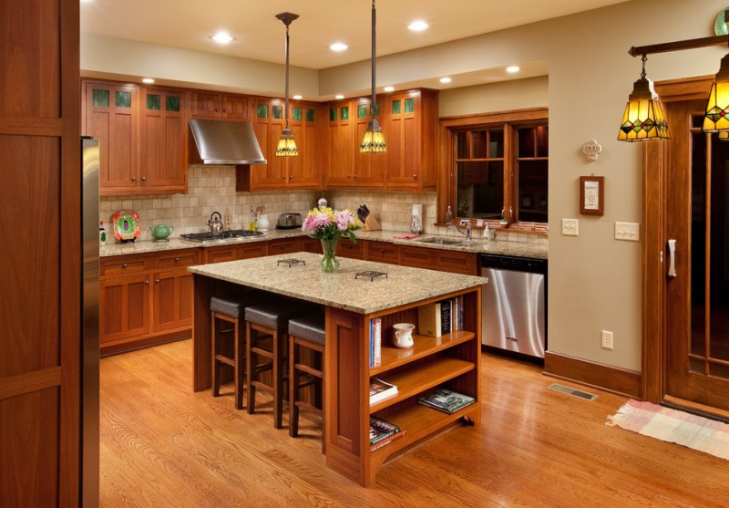craftsman kitchen idea with walnut cabinets island floors stainless steel appliances granite countertop beige walls beige colored subway ceramic tiles for backsplash